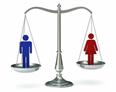 immagine di una bilancia con simboli di genere sui piatti - collegamento alla news