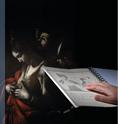 """immagine raffigurante una mano che sfiora l'immagine del """"Martirio di S. Orsola"""" sul libro tattile, sullo sfondo lo stesso dipinto del Caravaggio"""