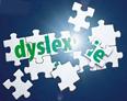 """immagine centrale del frontespizio della Guida, raffigurante un puzzle che compone la parola """"dyslexie"""""""