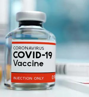 foto di una fiala con l'etichetta: Coronavirus Covid-19 Vaccine